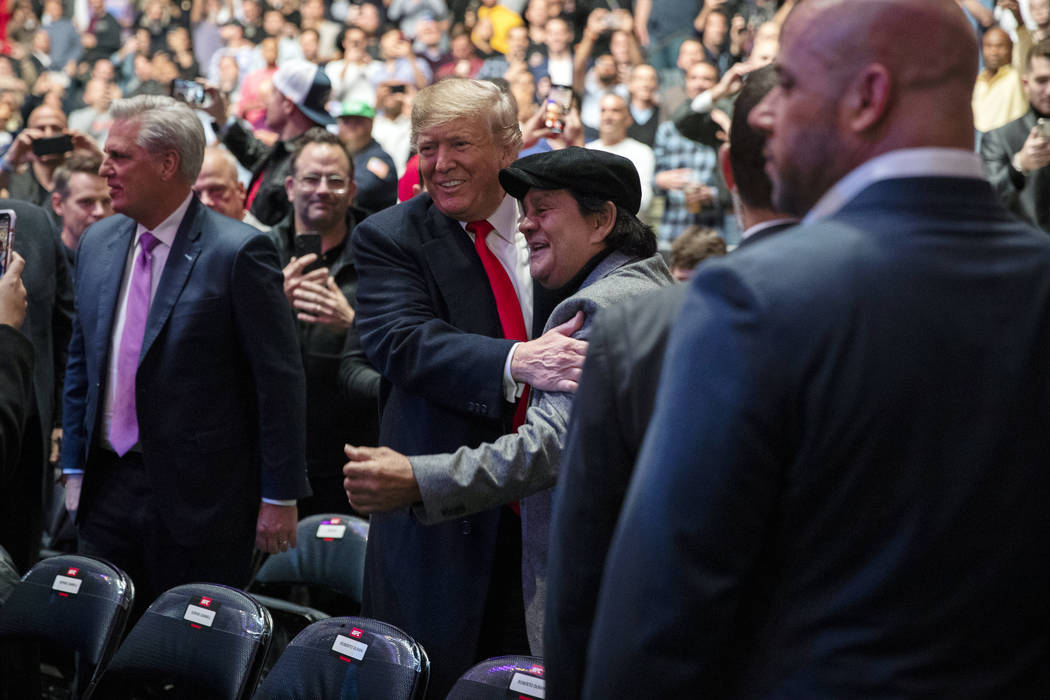 President Donald Trump talks with boxing legend Roberto Duran at Madison Square Garden during t ...
