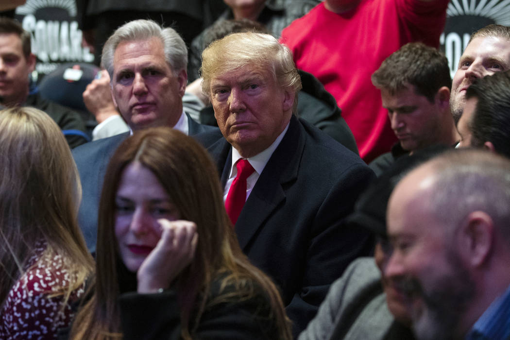President Donald Trump sits at Madison Square Garden for the UFC 244 mixed martial arts fights, ...