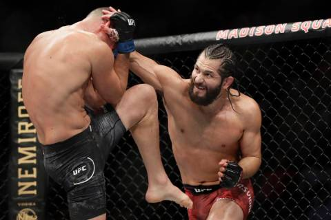 Jorge Masvidal, right, punches Nate Diaz during the second round of a welterweight mixed martia ...