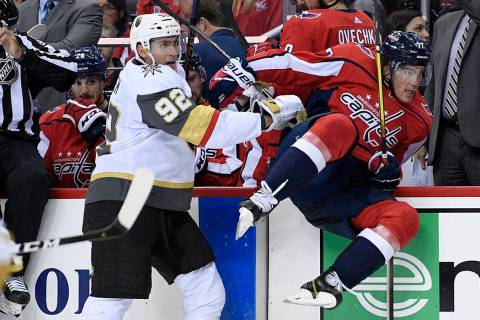 Vegas Golden Knights left wing Tomas Nosek (92) checks Washington Capitals right wing T.J. Oshi ...