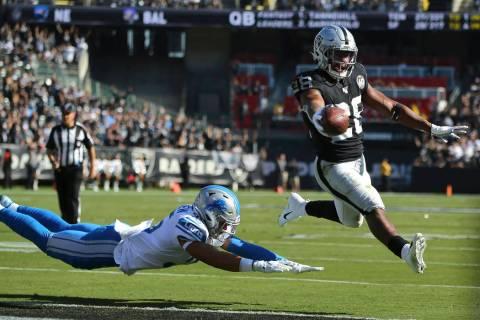 Oakland Raiders running back Josh Jacobs (28) runs for a touchdown past Detroit Lions defensive ...