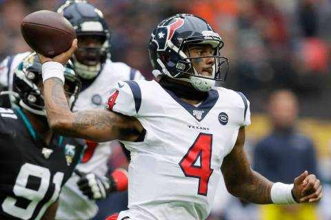 Houston Texans quarterback Deshaun Watson (4) runs out of the pocket under pressure by Jacksonv ...