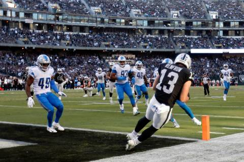 Oakland Raiders wide receiver Hunter Renfrow (13) catches a touchdown pass against the Detroit ...