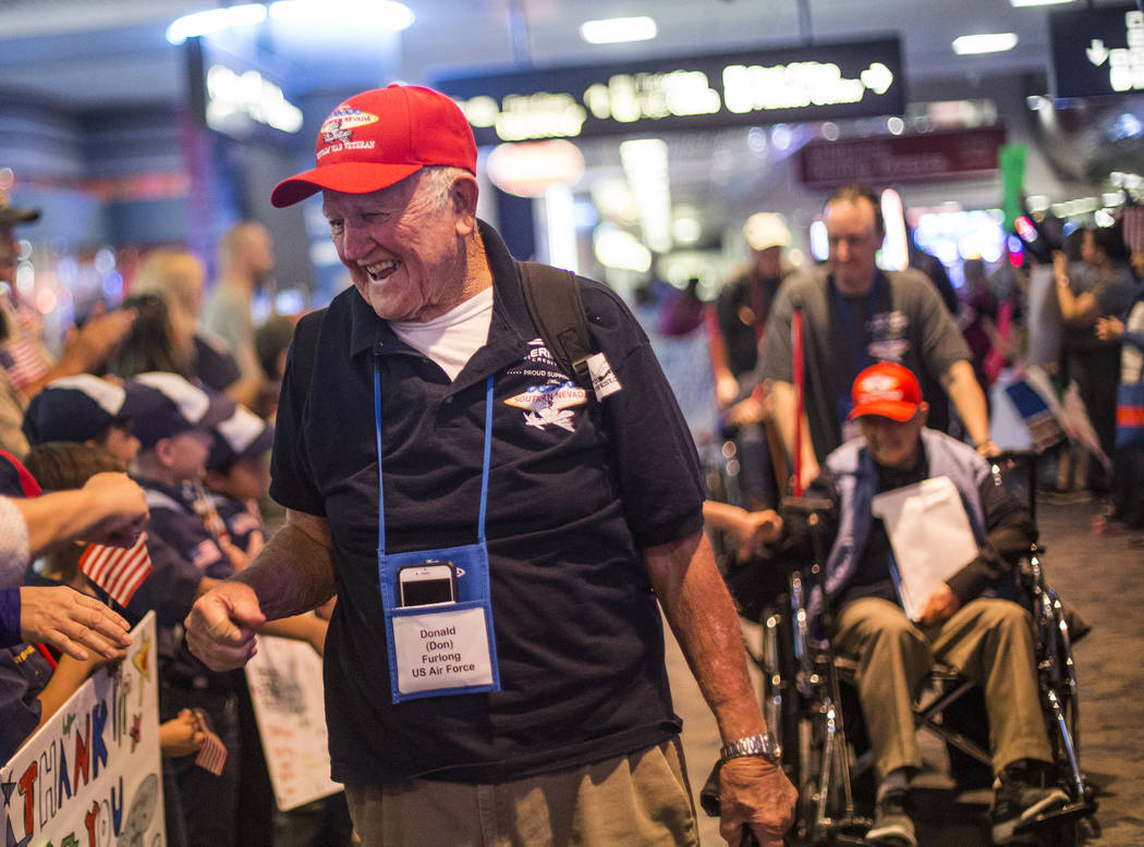 Don Furlong, a veteran of the U.S. Air Force, greets supporters after visiting the veteran memo ...