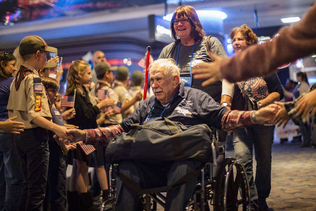 Frank Walls, a veteran of the U.S. Air Force, greets supporters after visiting the veteran memo ...