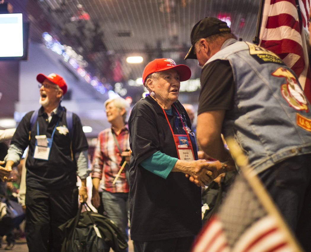 Patricia Whitlock, a veteran of the U.S. Navy, greets supporters after visiting the veteran mem ...