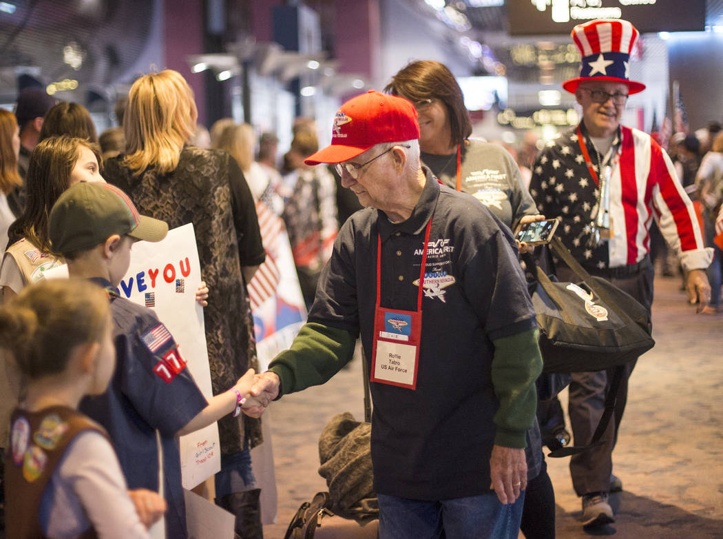 Rollie Tatro, a veteran of the U.S. Air Force, greets supporters after visiting the veteran mem ...