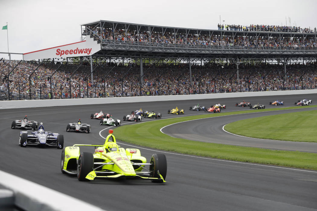 In a May 26, 2019, file photo, Simon Pagenaud, of France, leads the field through the first tur ...