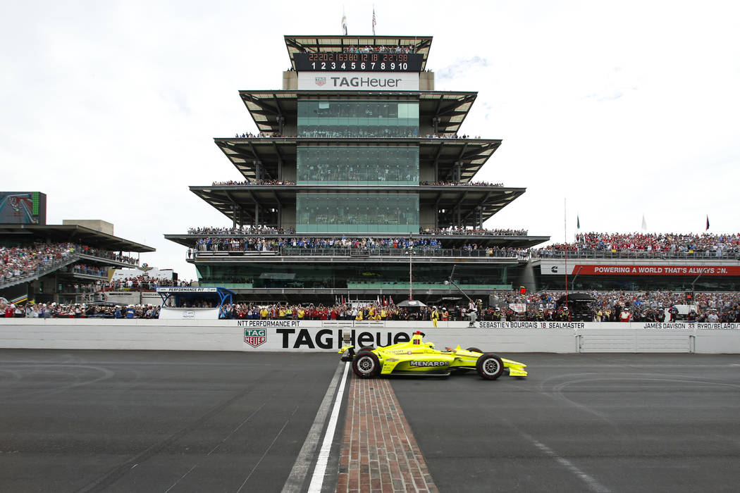 FILE - In this May 26, 2019, file photo, Simon Pagenaud, of France, crosses the start/finish li ...
