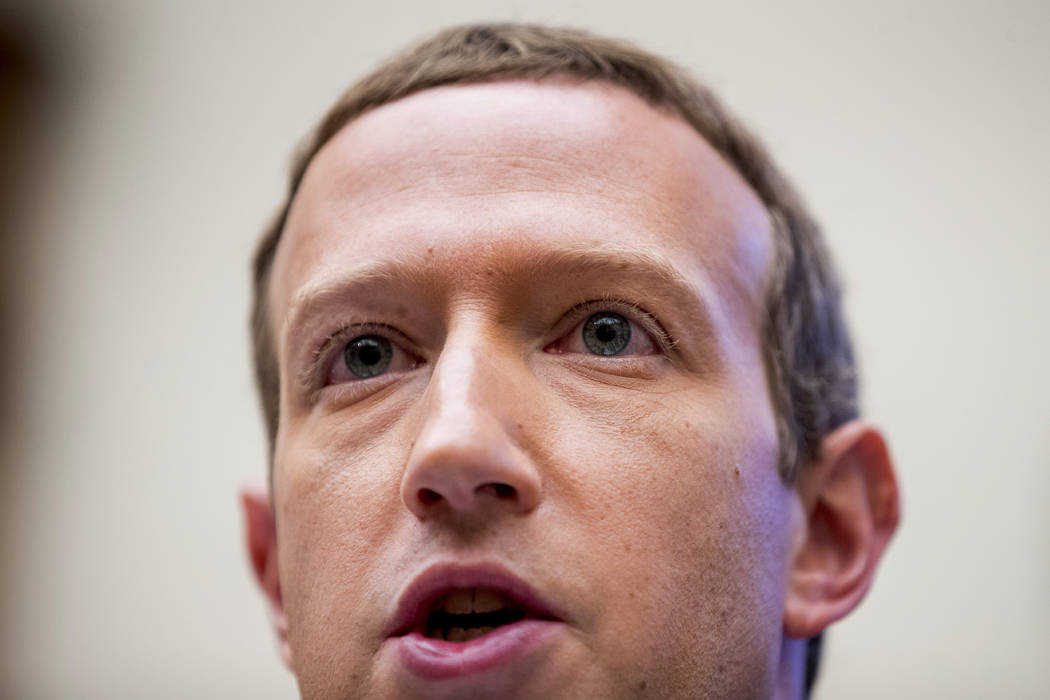 Facebook CEO Mark Zuckerberg testifies before a House Financial Services Committee hearing on C ...