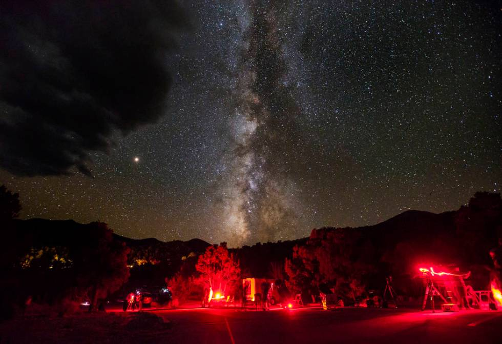 The Milky Way galaxy, along with Mars, center left, shines above Great Basin National Park duri ...