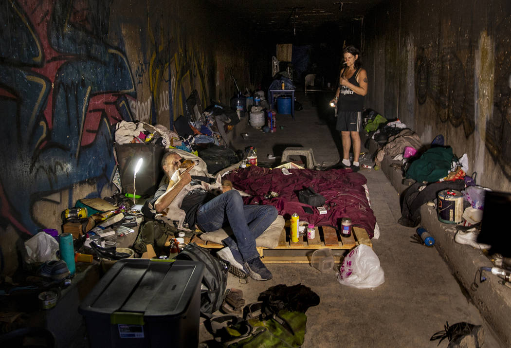 A homeless couple is pictured at home in the drainage tunnels near Dean Martin Drive in Las Veg ...