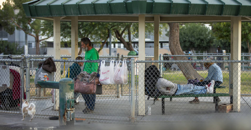Possessions hang on the chainlink fence about a homeless encampment at Molasky Family Park off ...