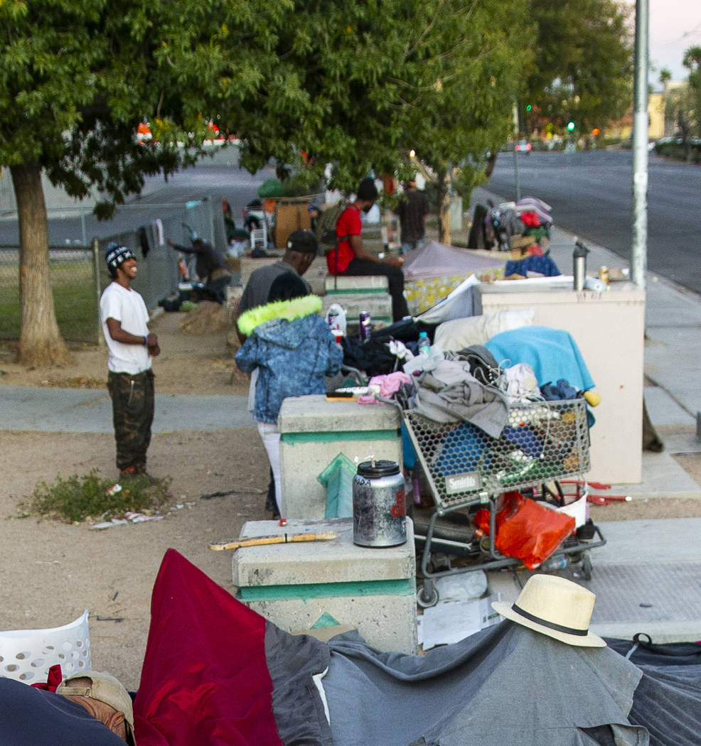 A myriad of possessions are gathered about a homeless encampment at Molasky Family Park off E. ...