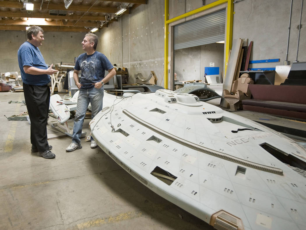 Paul Walker, left, and Alec Peters stand by a model of the Starship Voyager that was used as a ...