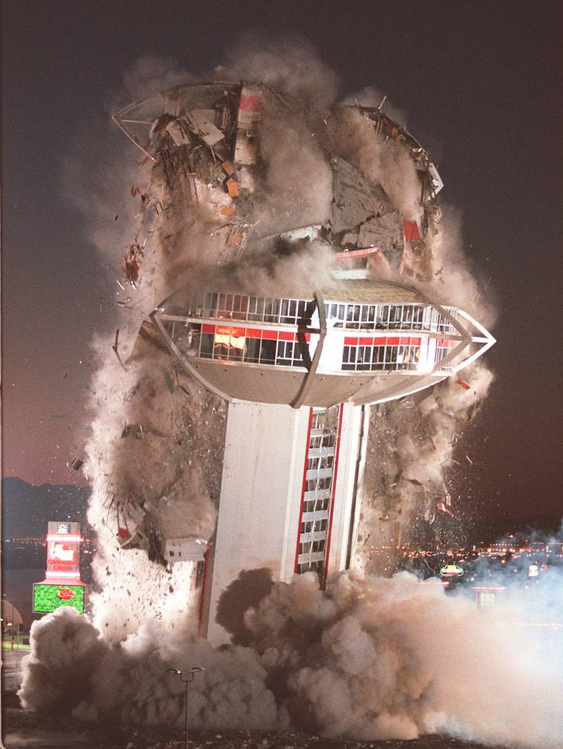 The tower of the Landmark hotel-casino comes crashing down during a planned implosion of the ic ...