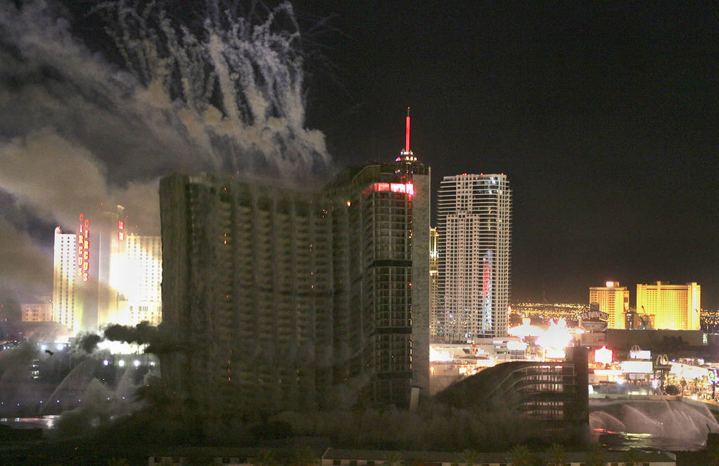 Behind an expanding cloud of dust the Stardust hotel-casino falls in on itself as it is implode ...