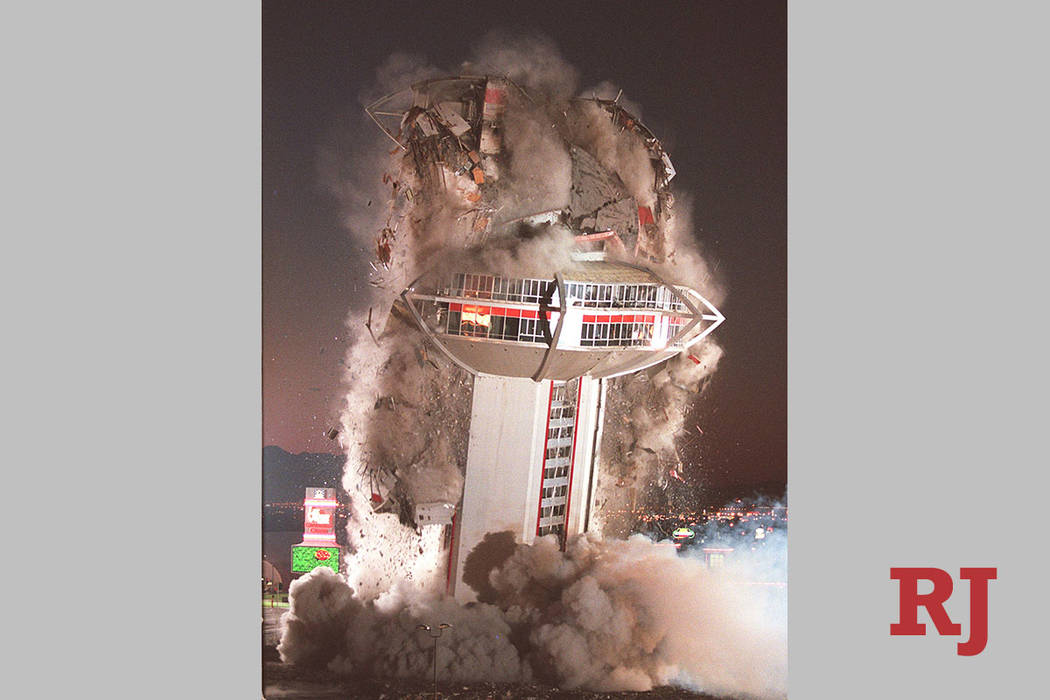 The tower of the Landmark hotel- casino comes crashing down during a planned implosion of the i ...