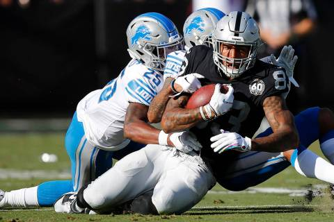 Oakland Raiders tight end Darren Waller (83) is tackled by Detroit Lions defensive back Will Ha ...