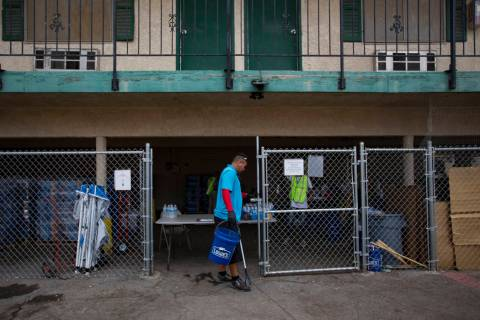 Harlan Thompson goes about his duties at the Courtyard Homeless Resource Center in Las Vegas, T ...