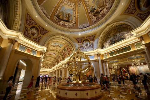 Guests mingle at the Armillary Sphere near the front desk at The Venetian on the Strip in Las V ...