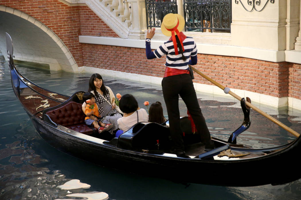 Kanako Arai of Japan, top left, and Reiko Yuasa, ride in a gondola with Arai's children Shotaro ...