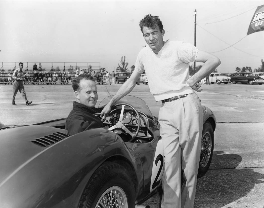 Charles Wallace, at wheel, Bethesda, Md., and Carroll Shelby, Dallas, Texas, are shown with the ...