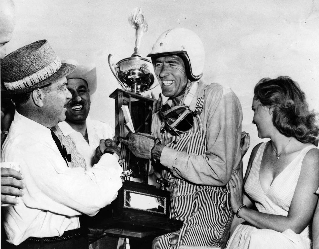 FILE - In this April 3, 1960 file photo, race car driver Carroll Shelby, center, of Dallas, rec ...