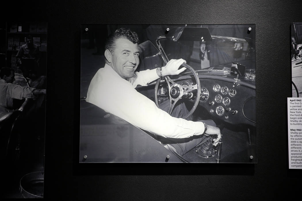 A 1962 photo of late car racing and car making legend Carroll Shelby in his first Cobra built i ...