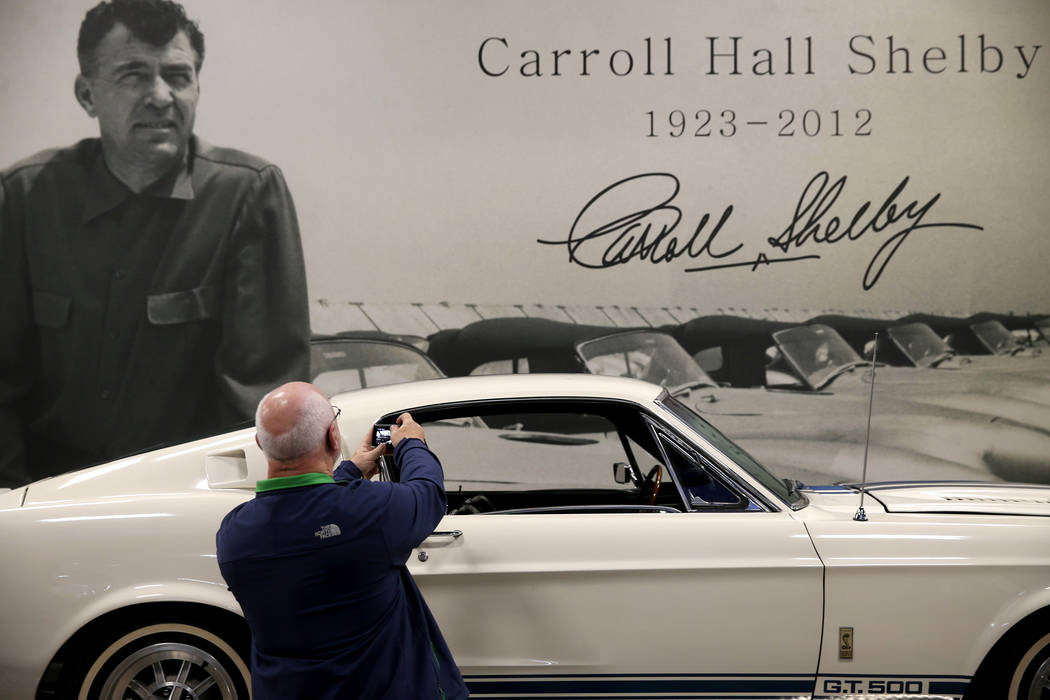 Ray Crawford of Rochester, N.Y., takes a photo of Carroll Shelby's original 1967 Super Snake GT ...