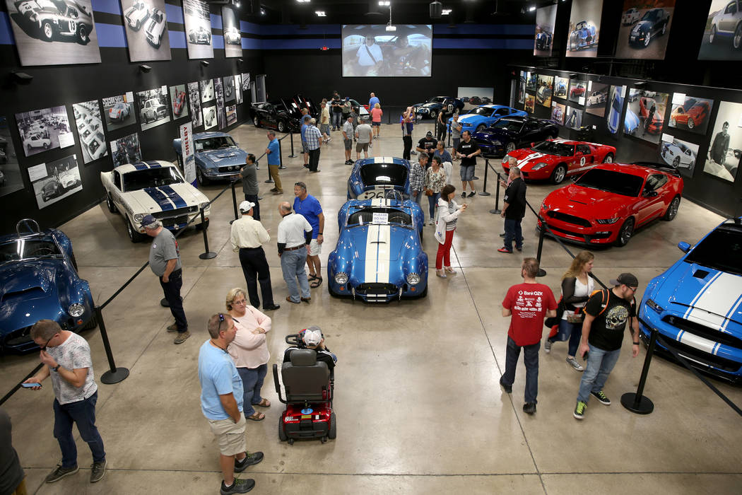Guests check out the Shelby Heritage Center in Las Vegas Monday, Nov. 4, 2019. Car racing and c ...