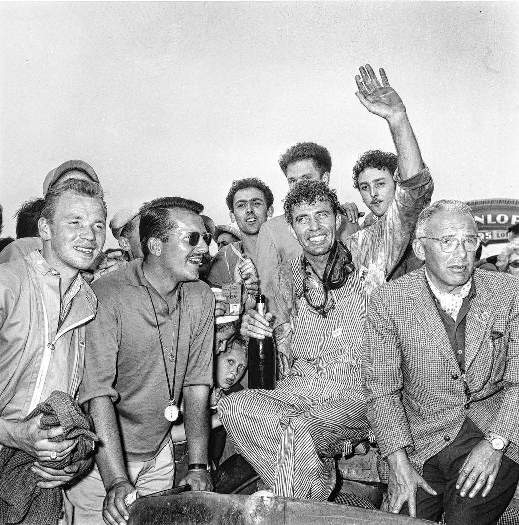 Race car driver Carroll Shelby, of Dallas, Texas, is surrounded by fans after winning the 24-ho ...