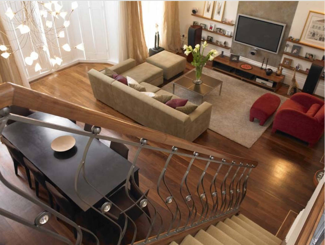 There's a lot of furniture in this space, but it clearly works and provides wonderful living ar ...