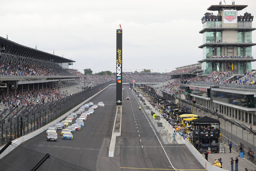 In this Sept. 8, 2019, file photo, Kevin Harvick, left, and Paul Menard lead the field into the ...