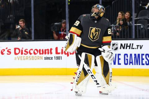Golden Knights goaltender Marc-Andre Fleury (29) looks up after giving up a goal to the Boston ...