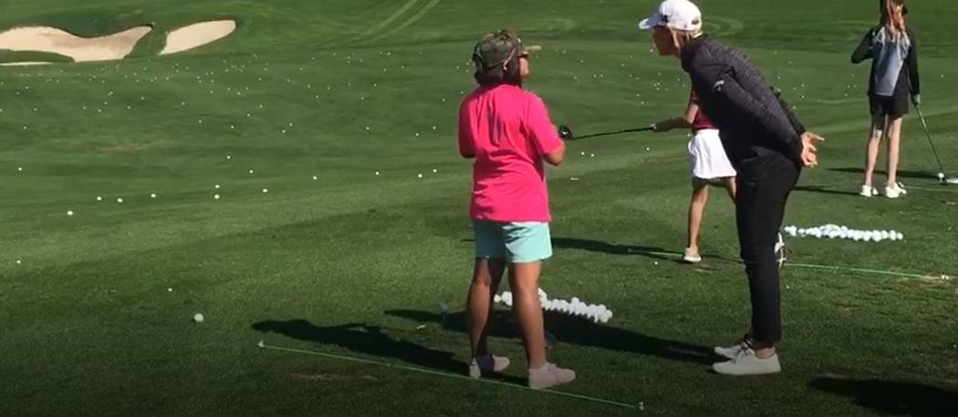 """Annika Sorenstam shares a swing tip with a Southern Nevada junior golfer during her """"Share My P ..."""