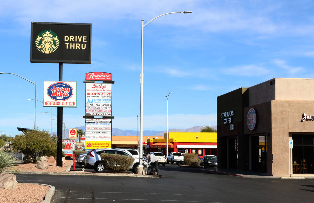 Las Vegas police have made an arrest in a fatal shooting at a business complex parking lot at 1 ...