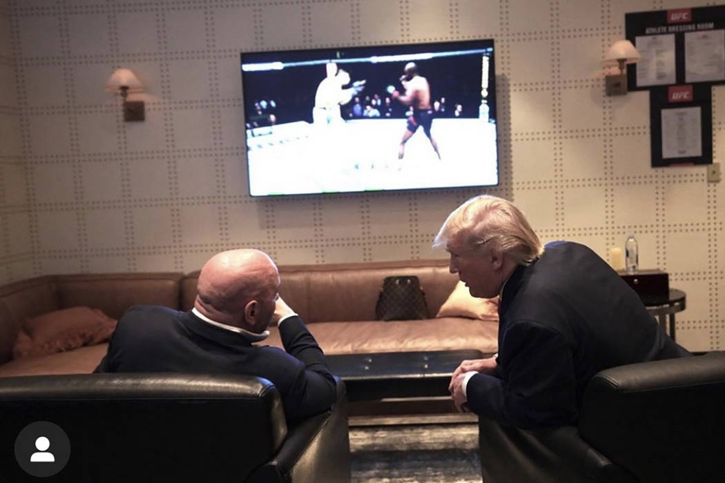 UFC President Dana White and President Donald Trump watch UFC 244 in a private room at Madison ...