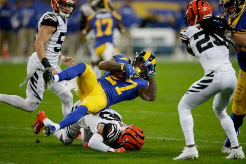 Los Angeles Rams running back Darrell Henderson (27) is tackled by Cincinnati Bengals free safe ...