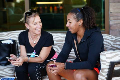 Rasheeda McAdoo (right) and her mom, Patrizia, chat after her match at the Henderson Tennis Ope ...