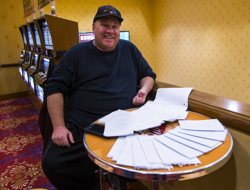 Dyer Lawrence poses with his college football playoff rankings at South Point in Las Vegas on F ...