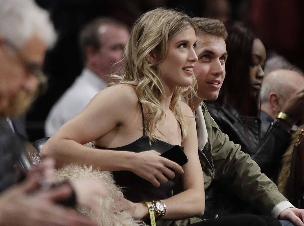 Genie Bouchard, left, sits with her blind date, John Goehrke, right, during the first half of a ...