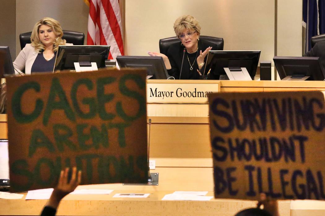 Councilwoman Michele Fiore, left, listens as Las Vegas Mayor Carolyn Goodman speaks during the ...