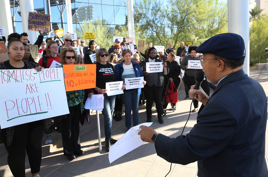 Rev. Leonard Jackson speaks outside Las Vegas City Hall during a protest against the city counc ...