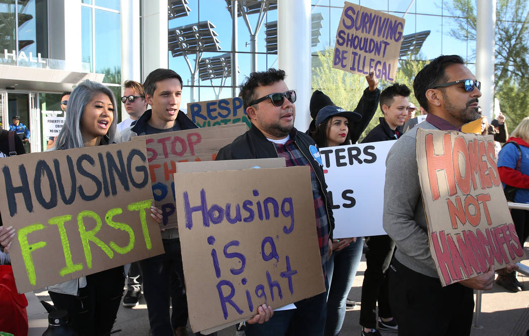 Protesters shout slogans as they hold signs outside Las Vegas City Hall during a protest agains ...