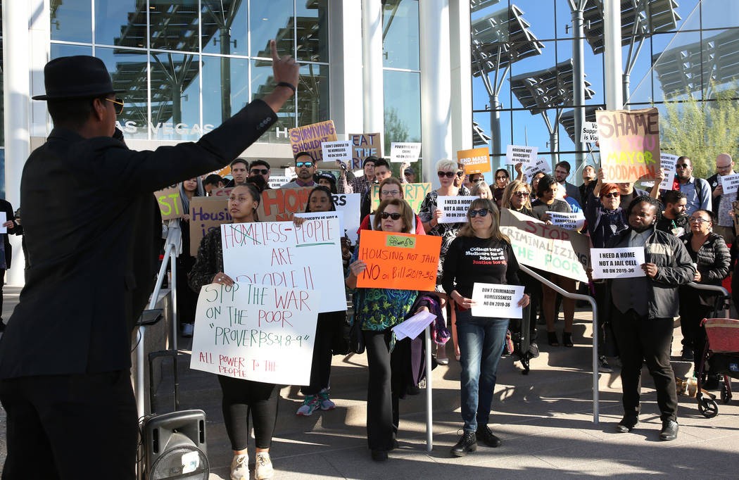 Minister Stretch Sanders speaks outside Las Vegas City Hall during a protest against the city c ...