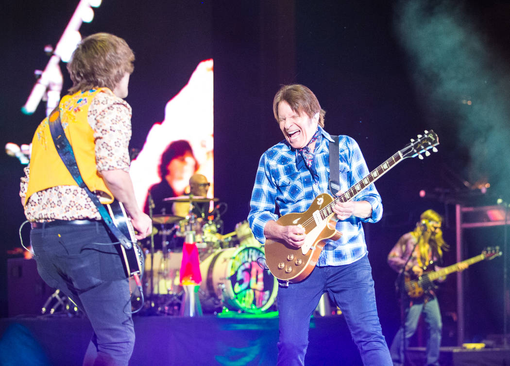 John Fogerty, shown with his son Shane, plays Red Rocks Amphitheater in Colorado on June 20, 20 ...