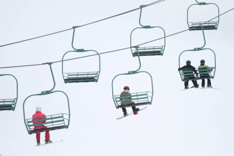 People ride a lift up the hill at Lee Canyon in Las Vegas, Friday, March 8, 2019. Erik Verduzco ...