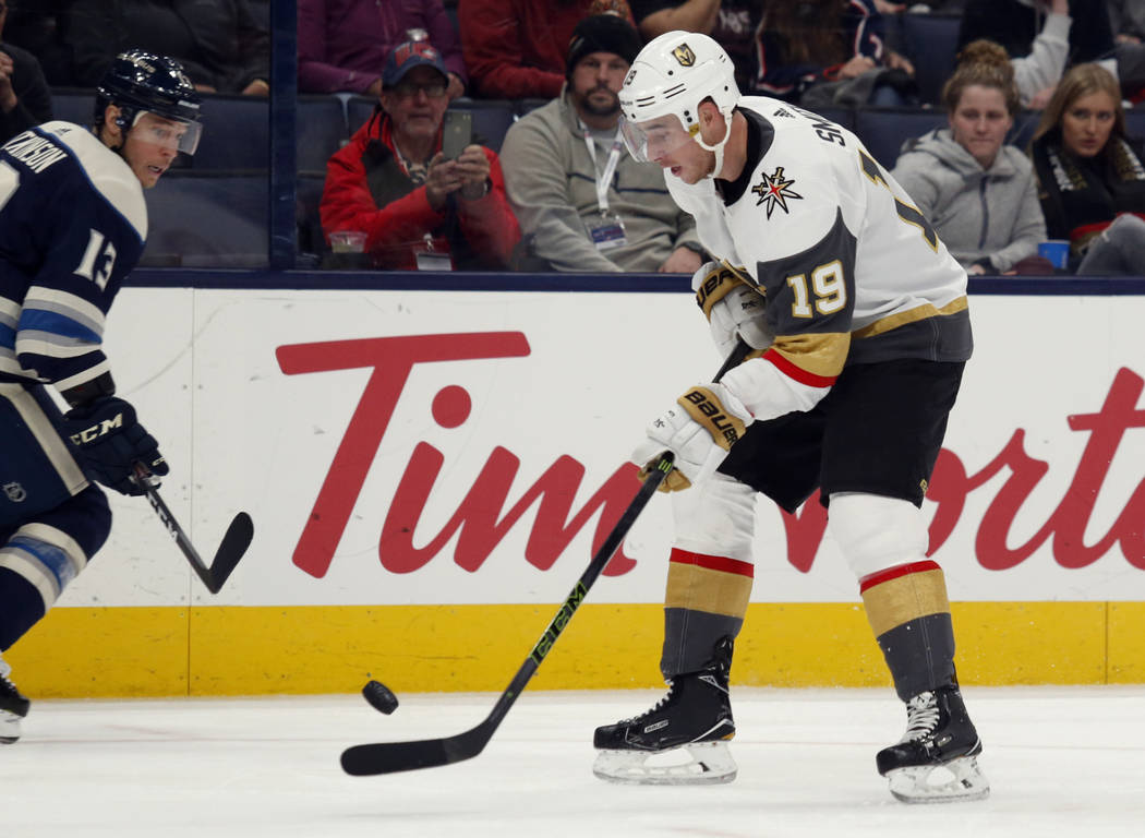 Vegas Golden Knights forward Reilly Smith, right, controls the puck in front of Columbus Blue J ...