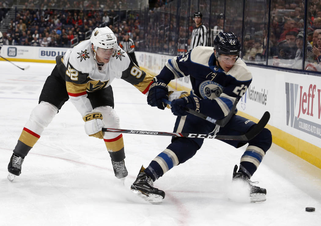 Columbus Blue Jackets forward Sonny Milano, right, chases the puck in front of Vegas Golden Kni ...